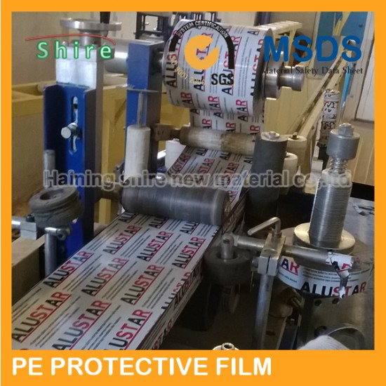 Protective plastic film covering the stainless steel surface